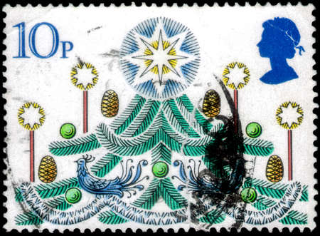 Saint Petersburg, Russia - April 01, 2020: Stamp issued in the United Kingdom with the image of the Christmas Tree. From the series on Christmas, circa 1980 Editorial