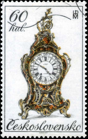 Saint Petersburg, Russia - May 31, 2020: Postage stamp issued in the Czechoslovakia the image of 18th century clocks. From the series on Historic clocks, circa 1979 新聞圖片
