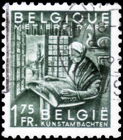 Saint Petersburg, Russia - September 18, 2020: Postage stamp issued in Belgium the image of the Woman making lace. From the series on Export Promotion, circa 1948