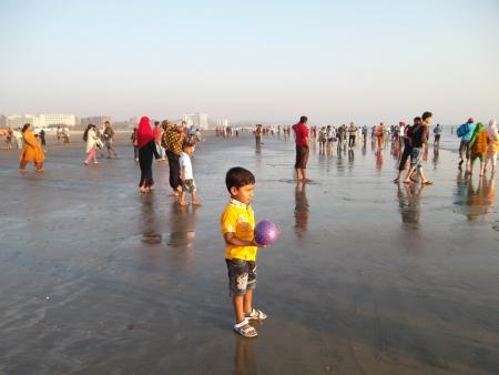 a boy in sea beach PLAY FOOTBALL Editorial
