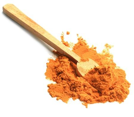 turmeric powder with wood sppon Stock Photo