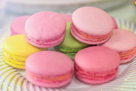 pink air macaroons are on the plate.Sweet pastries