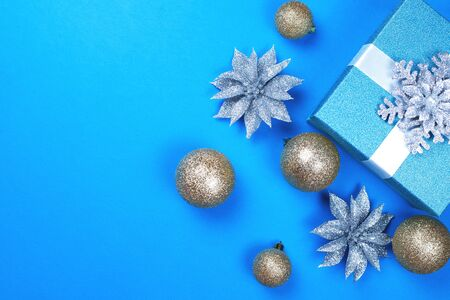 Christmas balls with a gift on a blue background Stock Photo
