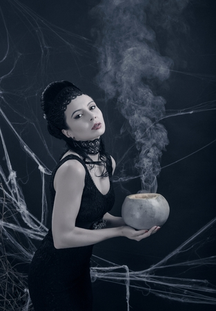 femme fatale: A young witch with magic potion