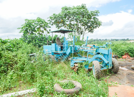 grader: Old worn out industrial grader. The consequences of war and the Ebola outbreak in Liberia