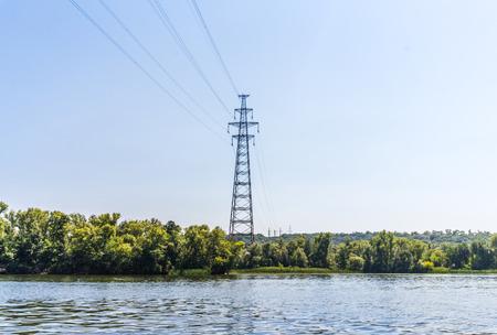 electricity export: High-voltage power line over a wide river. Ukraine