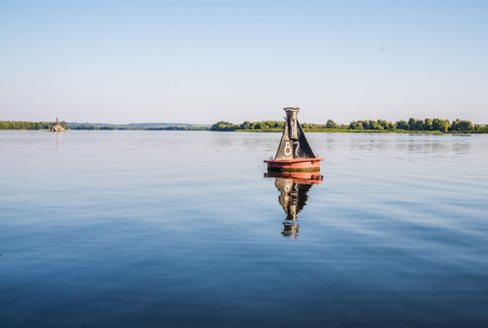guiding light: River buoy. The element of river navigation of vessels. Pointer distances and directions of movement
