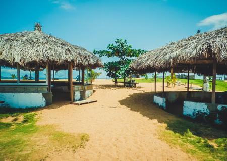 liberia: Primitive covered with reeds beach cabanas. Monrovia the capital of Liberia, Africa Stock Photo