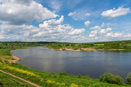 Stunning view from the hill on the Oka River and beautiful clouds in the blue sky Фото со стока