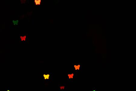 Multicolour bokeh butterfly shape ,the art from night lights