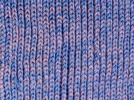 Knitted structure of blue threads of different shade. Vertical lines Banco de Imagens