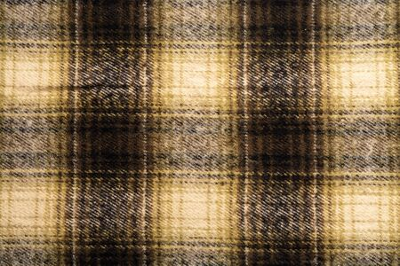 Close-up of background is checkered in brown and black in Scottish style.