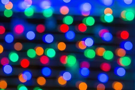 Beautiful bokeh in the form of small multicolored circles against dark background Banque d'images