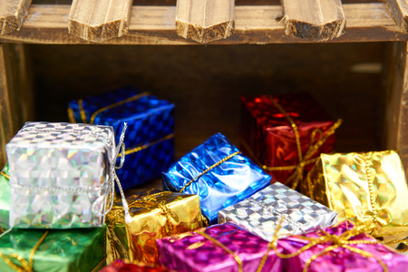 enrich: Colorful gift box drop off wood crate Stock Photo