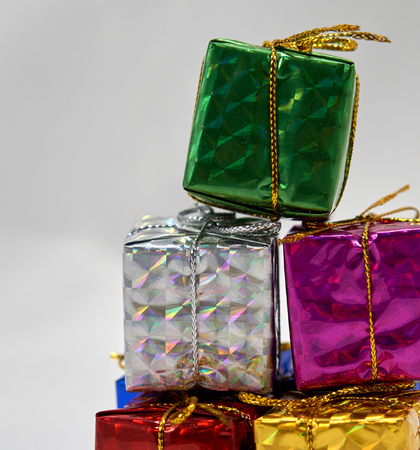 enrich: Colorful giftbox is pile up each other