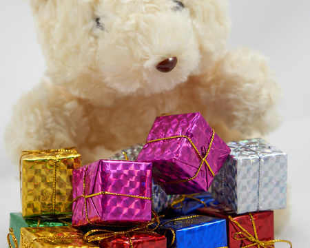 enrich: Colorful decoration gift box with teddy bear Stock Photo