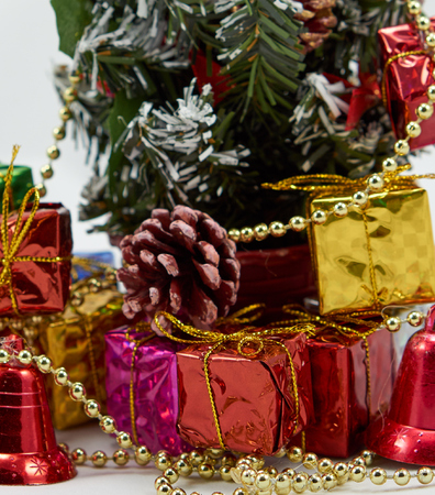 enrich: Colorful gift box place near the christmas tree