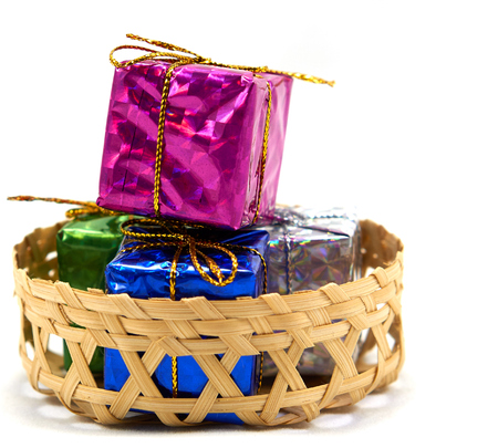 enrich: Colorful gift box in a bamboo basket Stock Photo