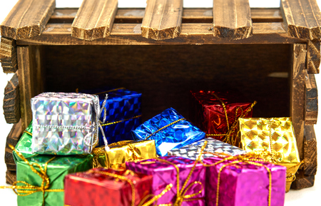drop off: Colorful gift box drop off wood crate Stock Photo