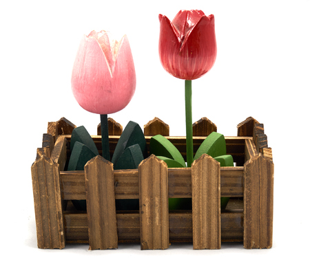 woodcraft: Decoration pink and red wood flower in fence