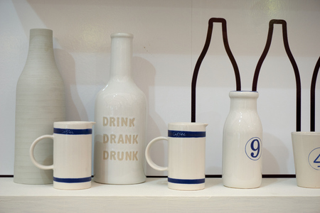 ceramic bottle: White ceramic coffee cup and bottle with drink drank drunk text