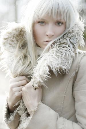 Portrait of a beautiful girl wearing white fur Stock Photo - 5899631