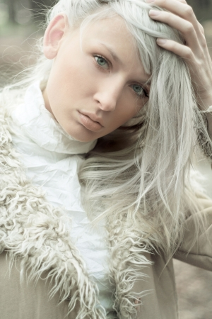 Portrait of a beautiful girl wearing white fur Stock Photo - 5899643