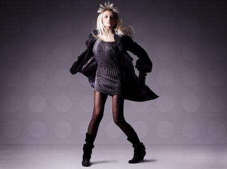 Fashion photo of a beautiful dancing blond girl Stock Photo - 5899710