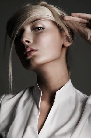 Young attractive blond female with creativity hairstyle Stock Photo - 5899713