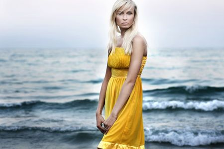 Young attractive blond beauty on beach photo