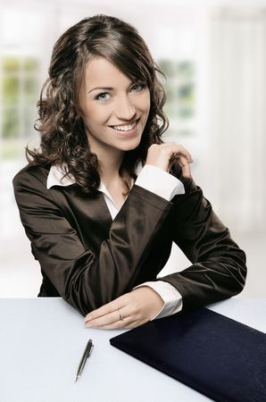 a modern portrait of a young professional businesswoman with pen, window in the background Stock Photo - 5899666