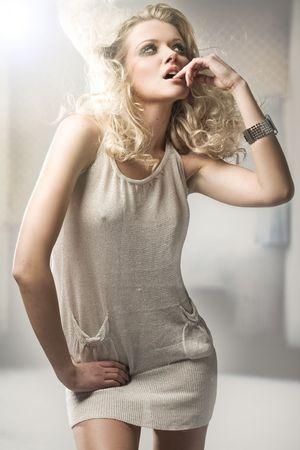 Studio shot of a young, beautiful, blond, fashionable woman Stock Photo - 5899712