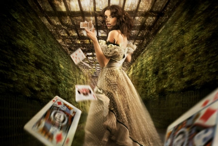bet: Vintage female magician throwing playing cards