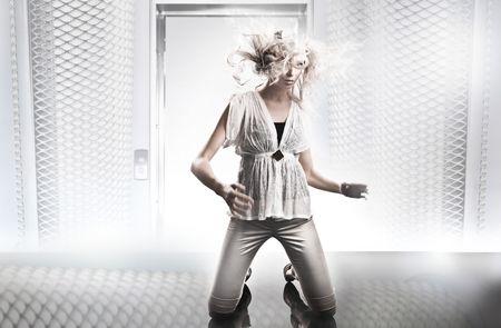 Beautiful blonde in white room Stock Photo - 5899774
