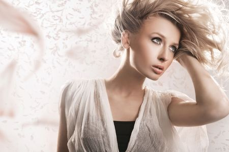 Young blond beauty with creativity hairstyle photo