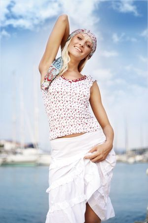 Young woman at the ocean, vogue look photo