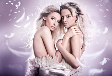 seducing: Nude portrait of two sensual young girls