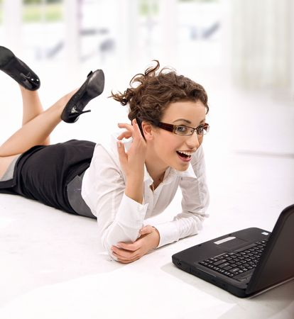 Happy young businesswoman with notebook photo