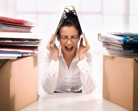 stressed woman: Angry secretary Stock Photo