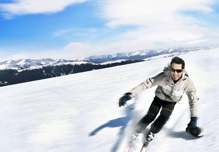 Skier on a slope Stock Photo - 7079055