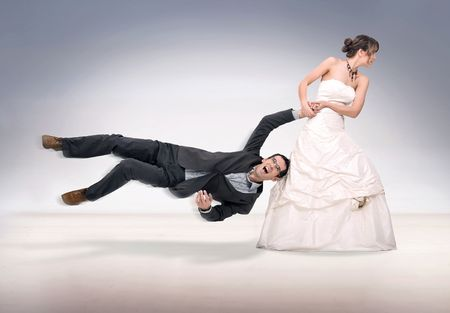 overpowered: bride abusing groom Stock Photo