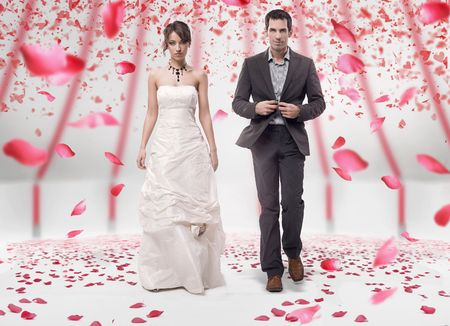 Wedding couple walking in roses photo