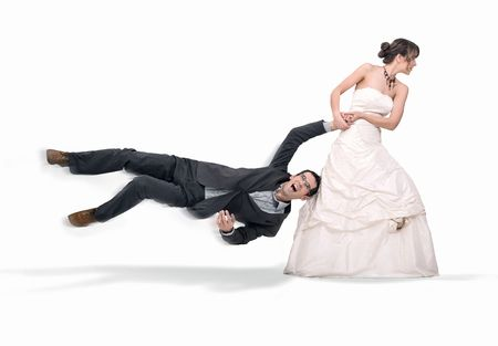 joking: Bride abusing groom, isolated on white