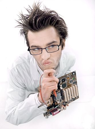 Mad technician repairing mainboard Stock Photo - 7079254