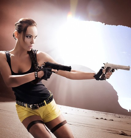 Gun woman strikes back Stock Photo - 8254831