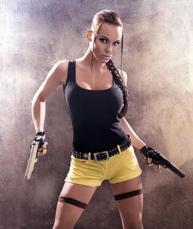 Gun woman strikes back Stock Photo - 8254980