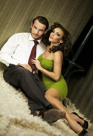 An attractive couple sitting on the floor Stock Photo - 8254928
