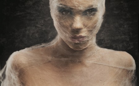self operation: Fine art portrait of a young woman in bandage Stock Photo