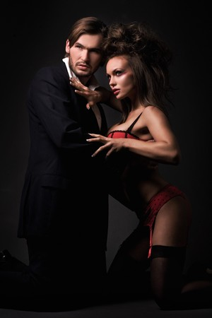 Attractive sexy couple in dark room Stock Photo - 8254895
