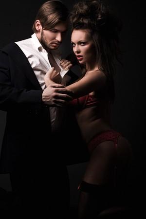 Attractive sexy couple in dark room Stock Photo - 8254924